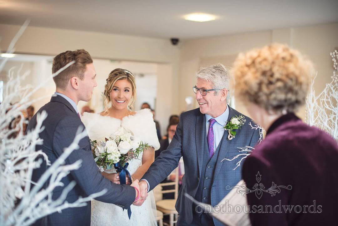 Father of the bride shakes grooms hand during Italian Villa Wedding ceremony in Poole