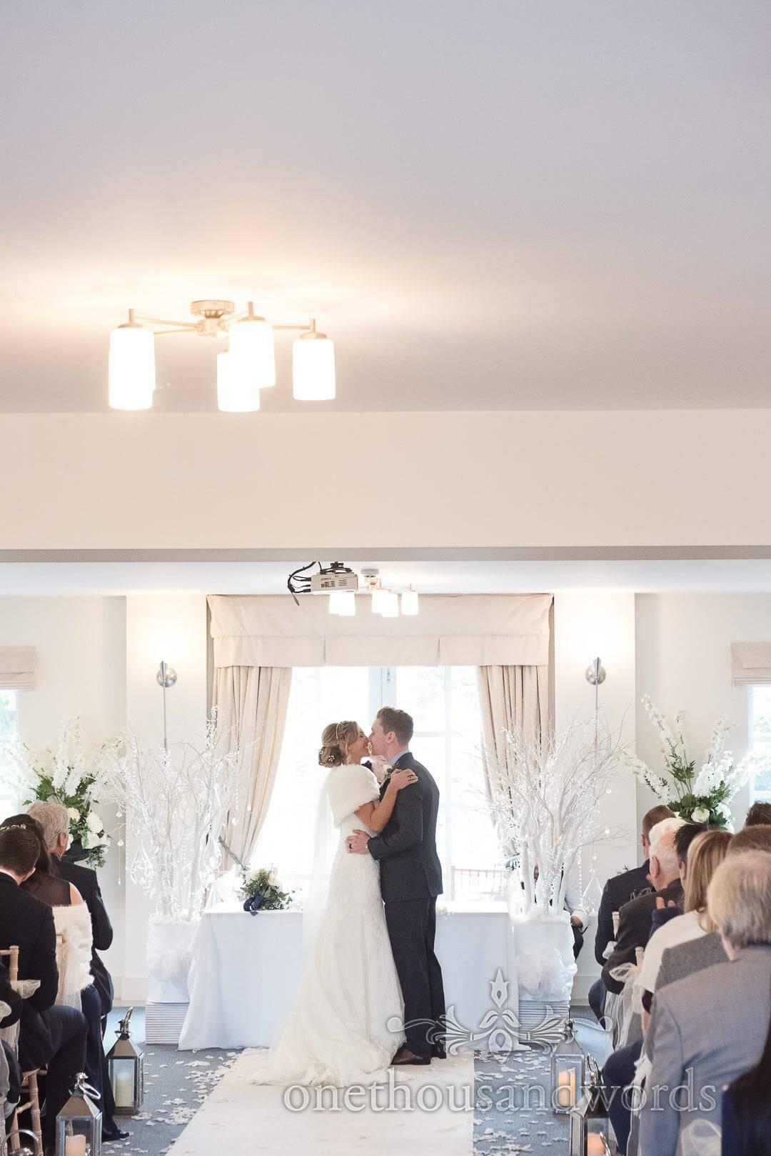 First Kiss at Winter Wonderland Italian Villa Wedding venue ceremony