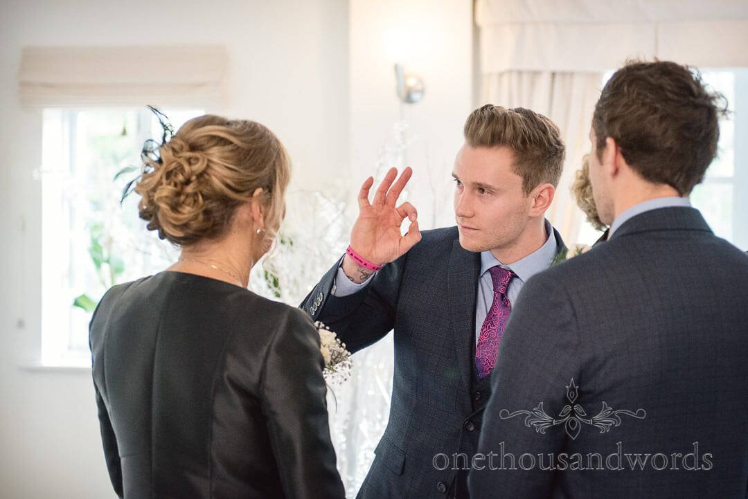 Groom adjusts bride's mothers hair to perfection before wedding at The Italian Villa