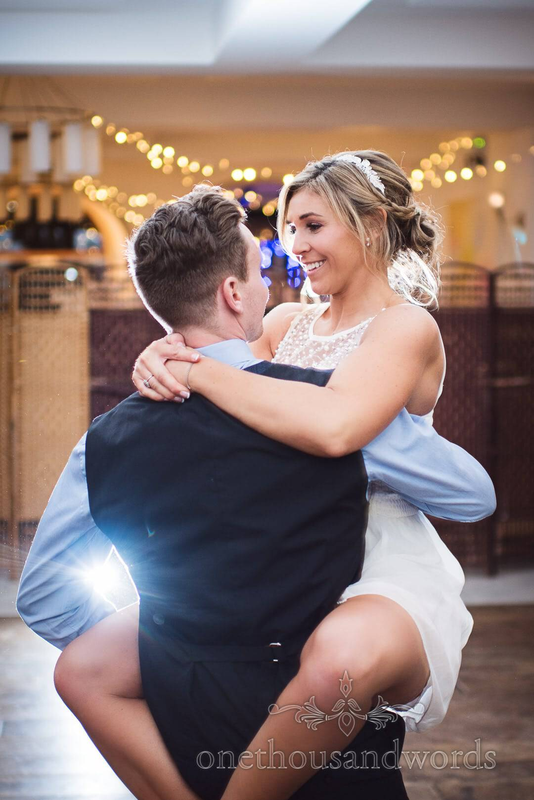 Groom lifts bride during choreographed first dance at The Italian Villa Wedding Photographs