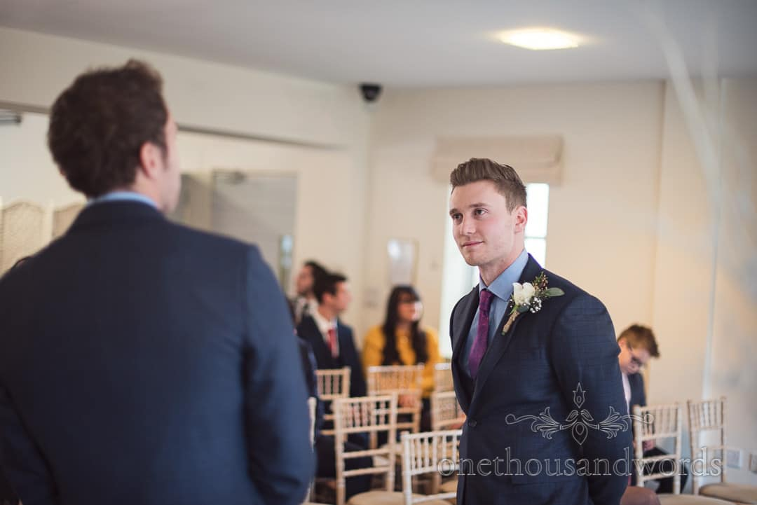 Groom patiently waits with his best man at Italian Villa wedding ceremony in Dorset