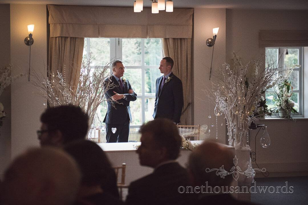 Groom's Father and best man surrounded by winter wonderland decorations at The Italian Villa