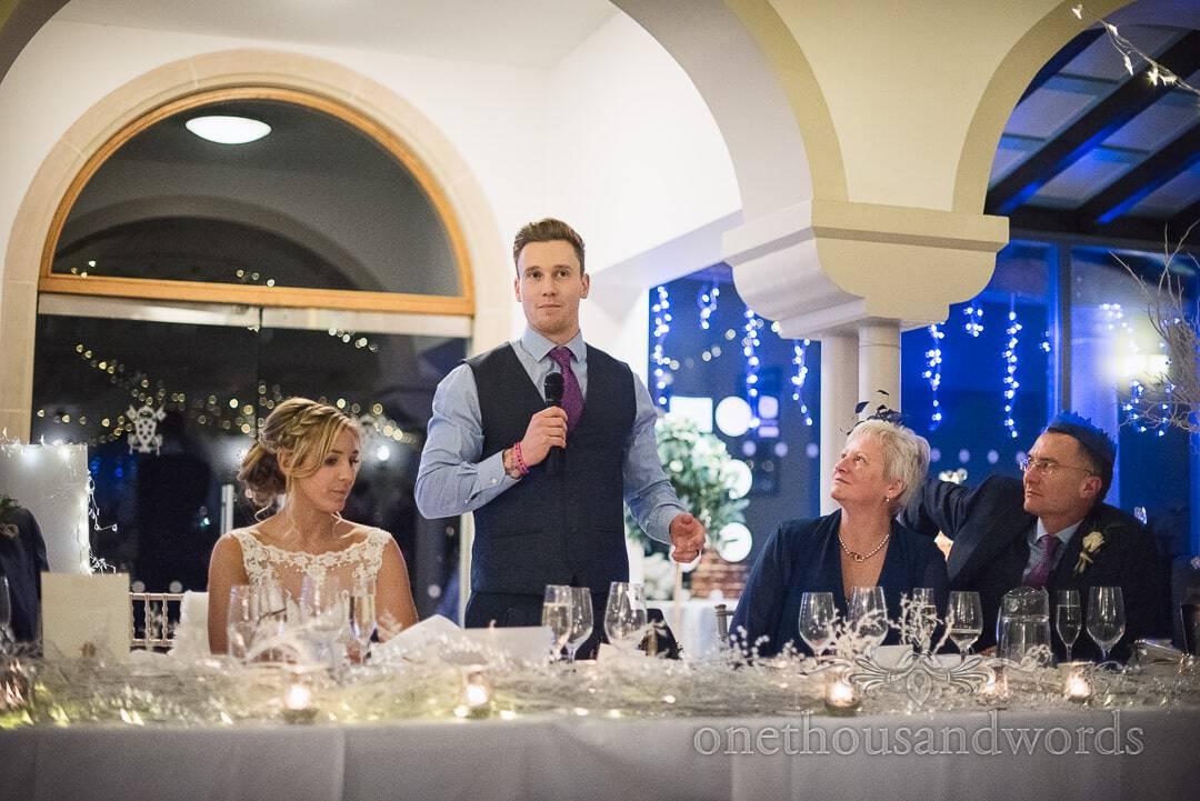 Groom's speech at The Italian Villa Wedding Venue top table with Christmas lights