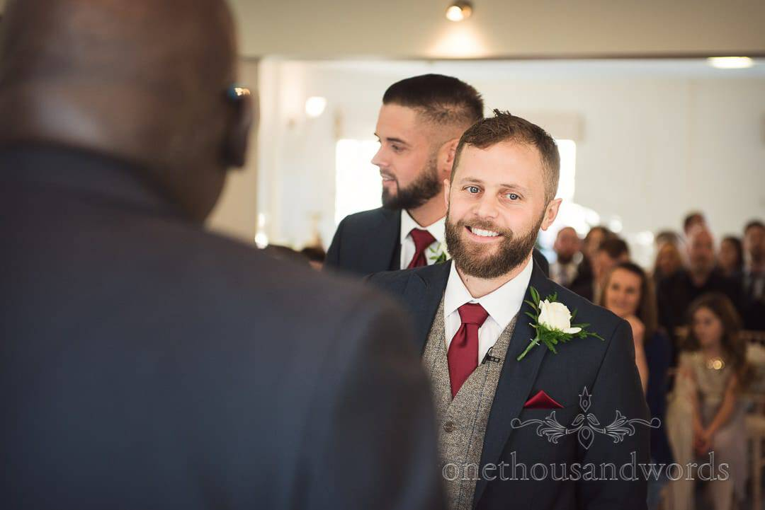 Groom waits with guests for the arrival of the bridal party at Italian Villa wedding photos