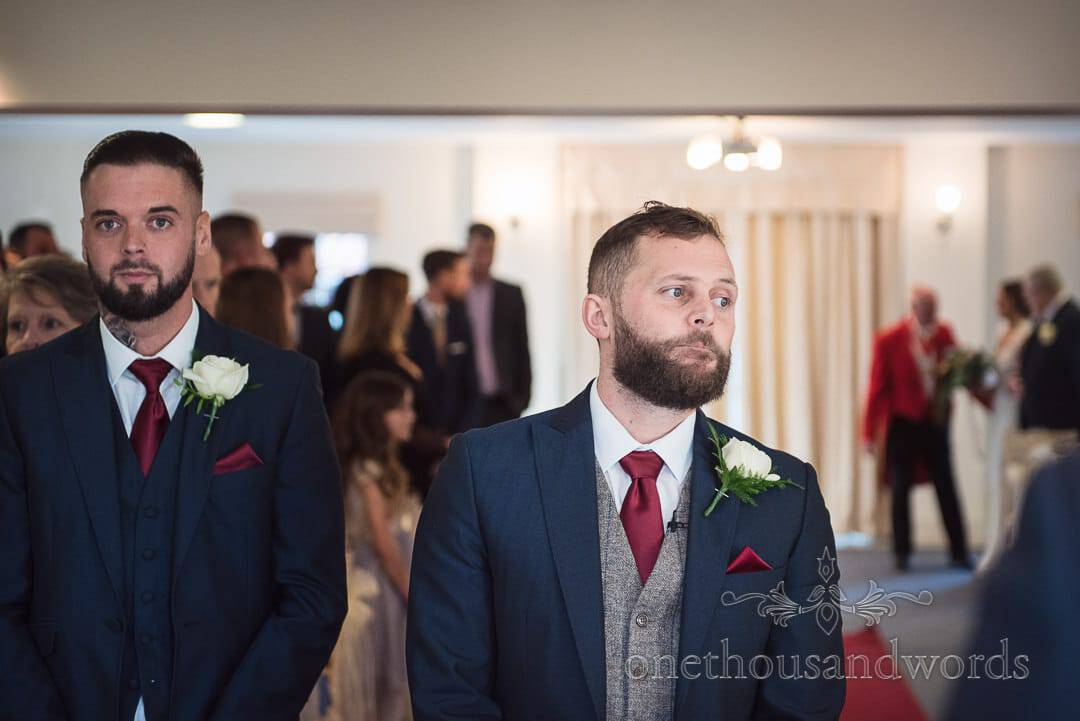 Groom waits with his best man as bride arrives with father at Italian Villa wedding photos