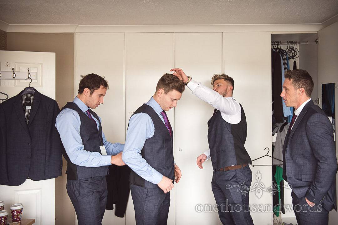 Grooms party wedding morning preparations on wedding morning photograph