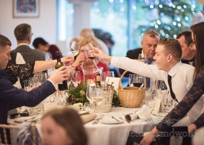 Guest raise a toast during reception at Italian Villa wedding photos