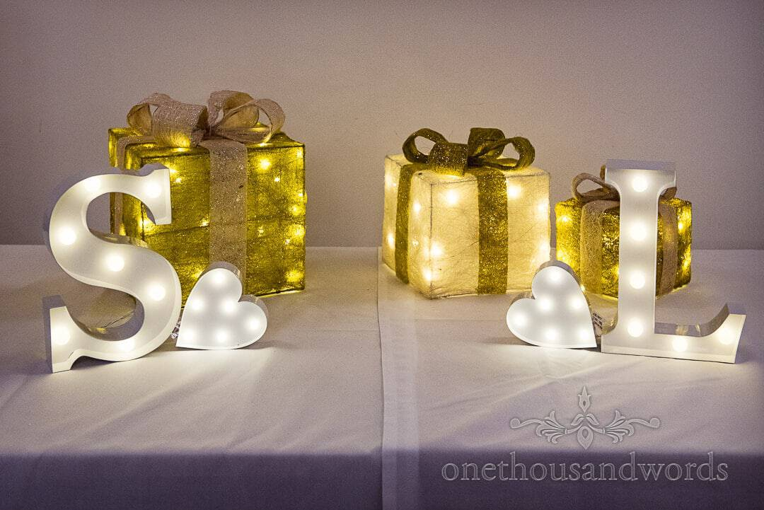 Illuminated wedding name initial letters with illuminated Christmas present decorations