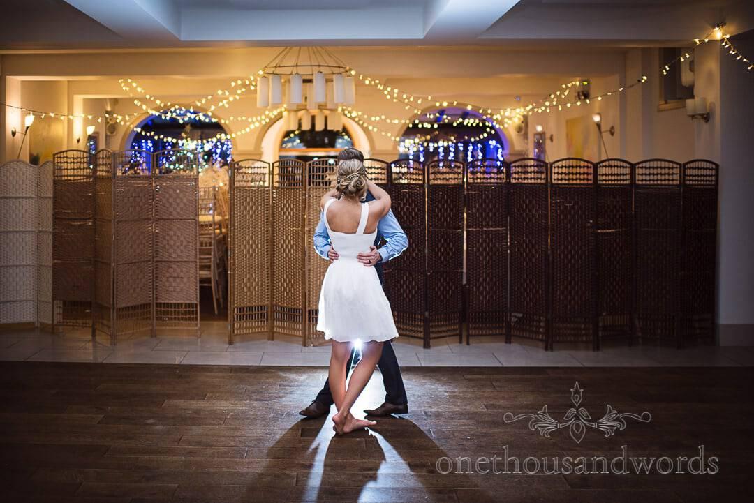 Italian Villa Wedding Photographs of choreographed first dance with fairy lights