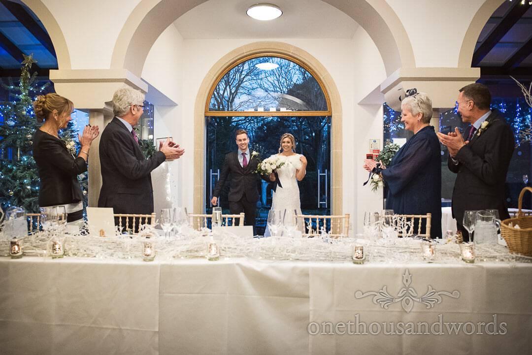 Italian Villa Wedding photographs of top table applauding bride and groom's entrance