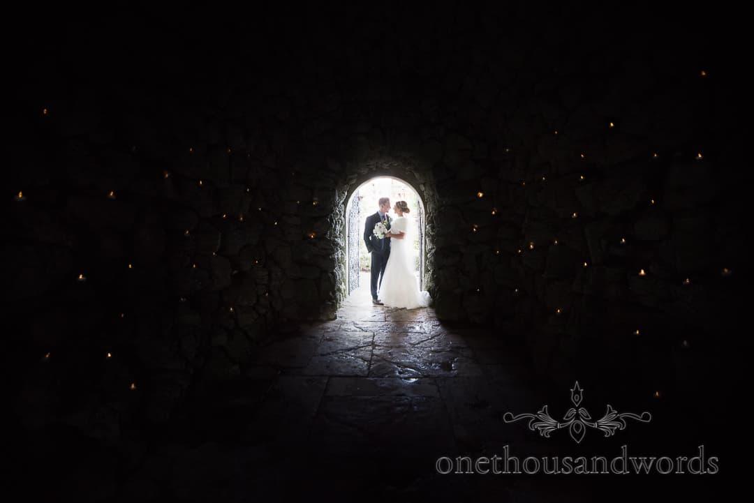 Italian Villa Wedding Venue photographs bride and groom in candle lit cave