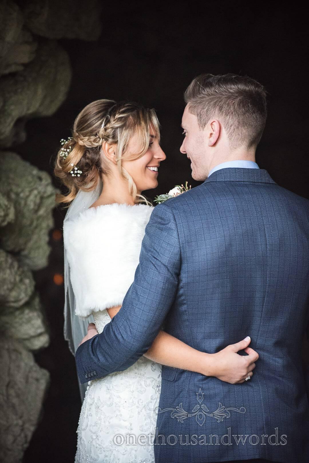 Italian Villa Wedding Venue photographs bride and groom portrait at cave entrance