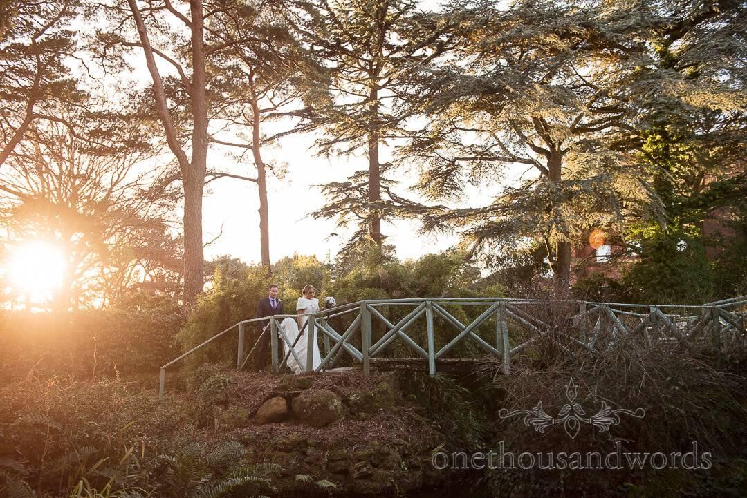 Italian Villa Wedding Venue photographs of bride and groom on garden bridge at Sunset