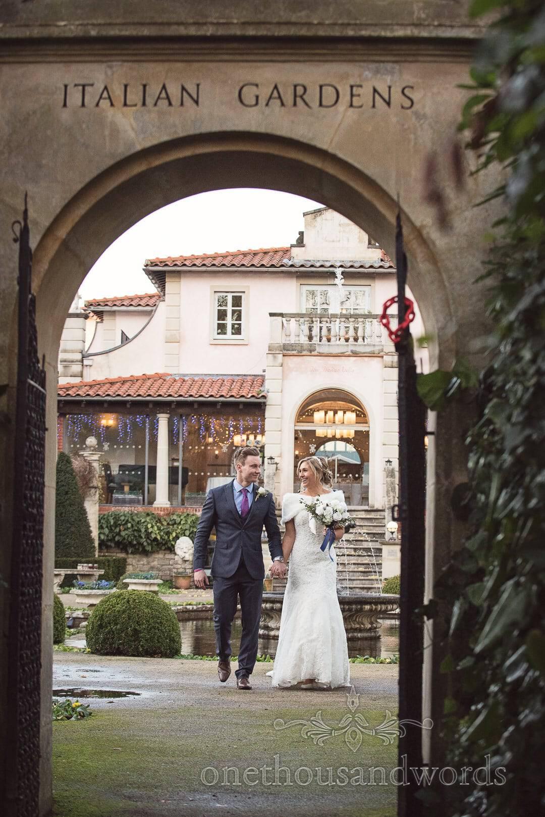 Italian Villa Wedding Venue photographs of bride and groom walking into gardens