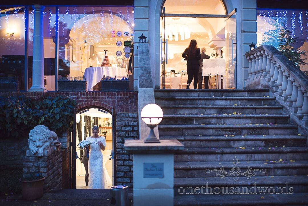 Italian Villa Wedding Venue Photographs of bride in doorway with stone staircase