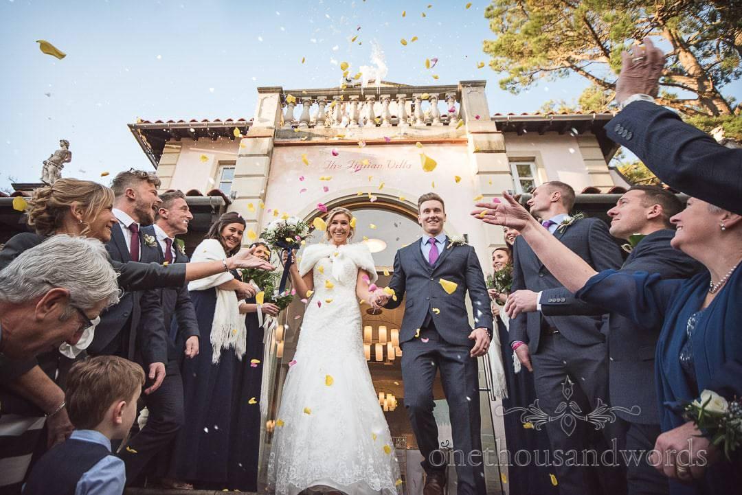 Italian Villa Wedding Venue photographs of snow machine and confetti at Winter Wedding