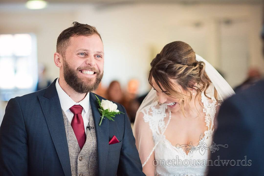 Laughing bride and groom during ceremony at Italian Villa wedding photos