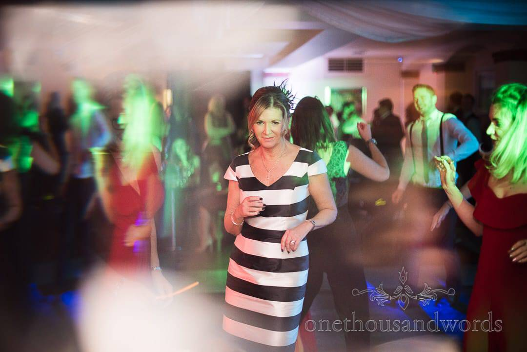 Mother of the bride in black and white striped dress dancing at Italian Villa Wedding