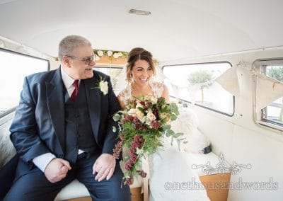 Smiling bride and father in VW wedding van on way to Italian Villa