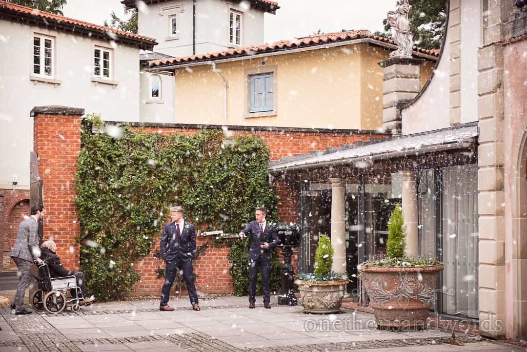 Ushers welcome guests to The Italian Villa as Snow Machine creates small blizzard