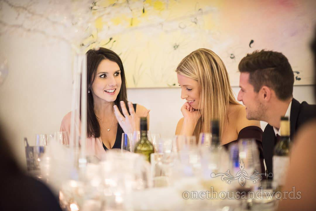 Wedding guest enjoy conversation during wedding breakfast at The Italian Villa