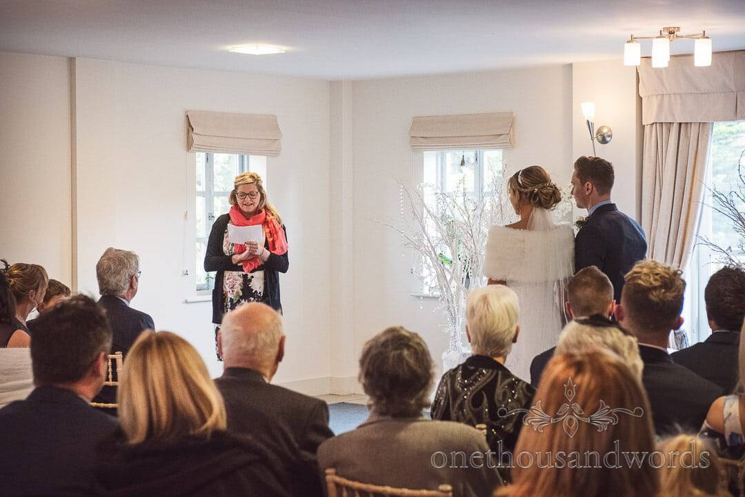 Wedding guest gives reading during Italian Villa wedding ceremony in Poole, Dorset