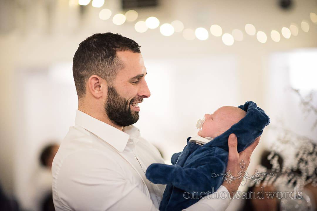 Wedding guest smiles at very small baby at Italian Villa wedding venue