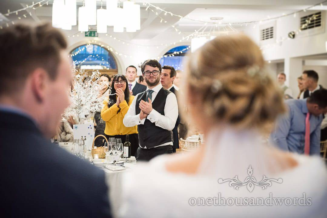 Wedding guests applaud the entrance of the bride and groom at The Italian Villa
