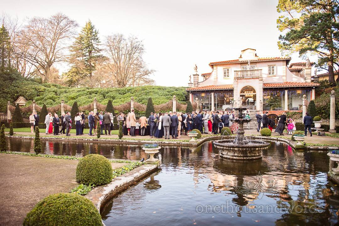 Wedding guests enjoying mulled wine in the gardens at Italian Villa wedding venue