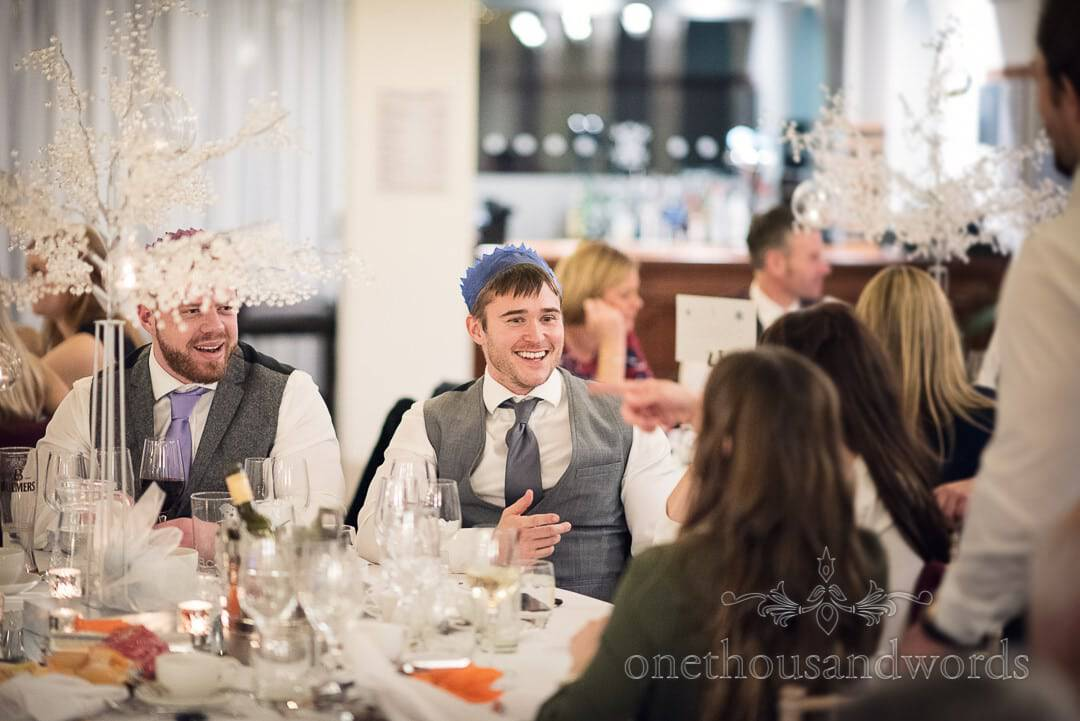 Wedding guests in Christmas hats surrounded by winter decorations at Italian Villa