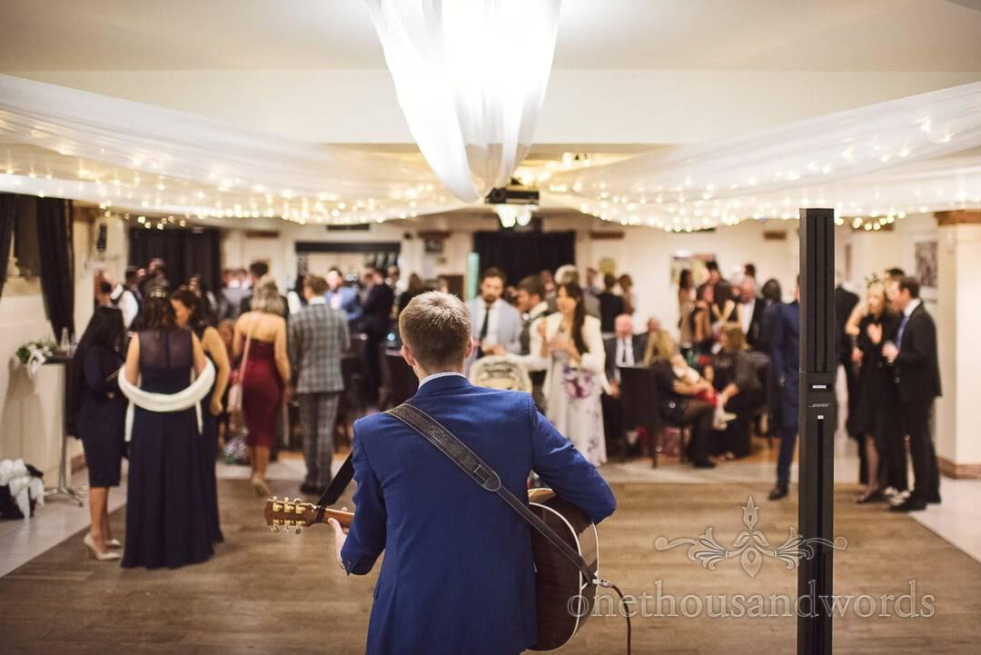 Wedding guitar entertainment during wedding drinks reception at The Italian Villa