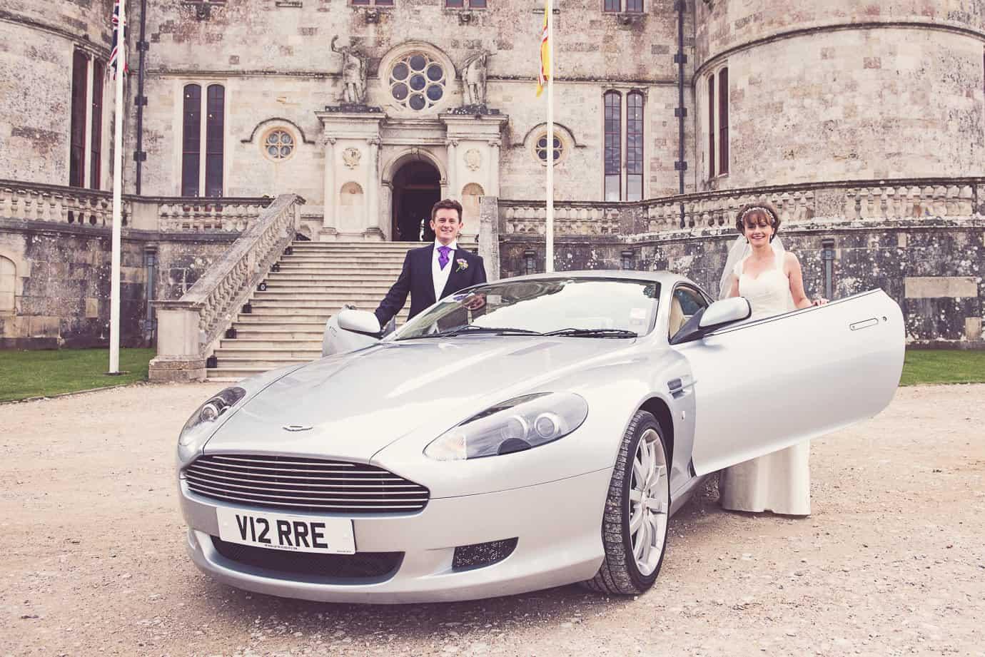 Aston Martin DB9 wedding car at Lulworth Castle wedding venue in Dorset