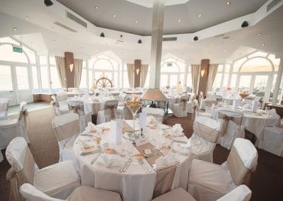 Beach theme venue styling at Sandbanks Hotel wedding venue Compass room