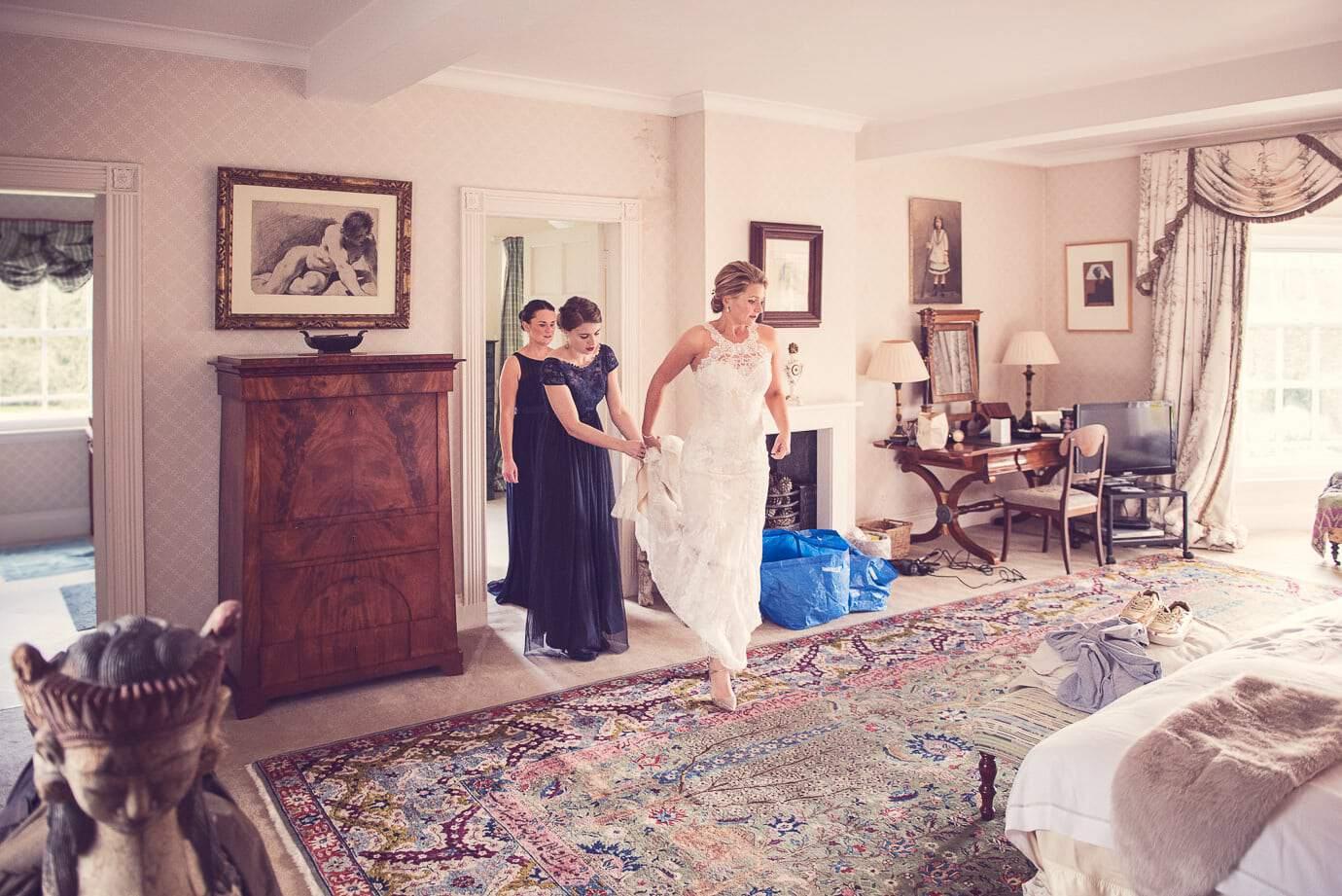 Bride and bridesmaids in Plush Manor wedding venue bedroom bridal preparations