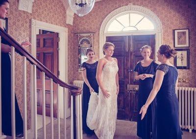 Bride and bridesmaids in Plush Manor wedding venue in Dorset entrance hall