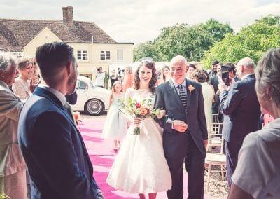 Bride and father walk down the aisle at Stockbridge Farm Barn wedding