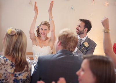 Bride applause wedding speeches in old church at Plush Manor wedding venue