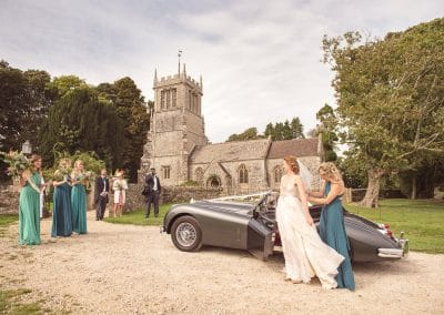 Bride arrives at Lulworth Castle church wedding venue in Dorset Countryside