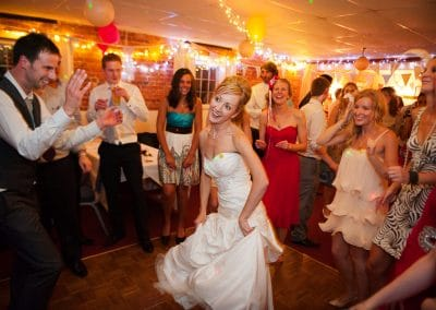 Bride dances surrounded by wedding guests on Sopley Mill wedding dance floor