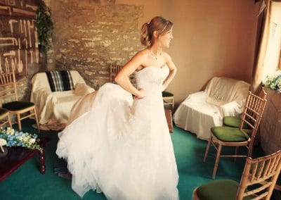 Bride has wedding dress adjusted at Stockbridge Farm Barn wedding