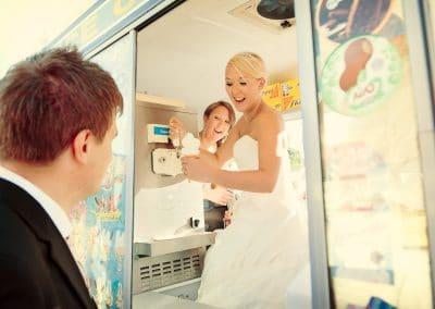 Bride makes groom an ice cream from ice cream van at Stockbridge