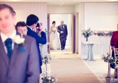 Bride walks down aisle with father at Sopley Mill wedding ceremony in Dorset