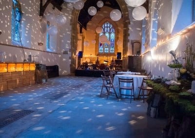Church set up for wedding evening reception with band and lighting at Plush Manor