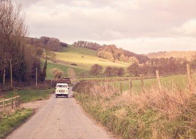 Classic Land Rover wedding car drives through Dorset countryside to Plush Manor