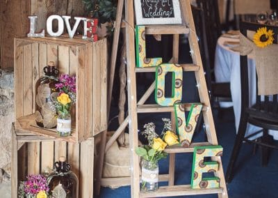 Countryside wedding styling details with LOVE signs and step ladder