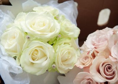 Cream and Pink wedding rose bouquets by Sandbanks Hotel wedding photographers
