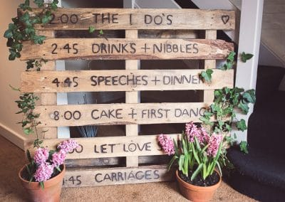 Decorative Wooden pallet wedding order of the day sign at Sopley Mill wedding