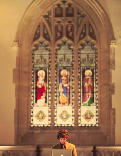 DJ with Apple Mac in Stone church at Plush Manor wedding evening reception
