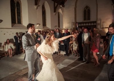 First dance at Plush Manor church wedding evening reception bride pointing