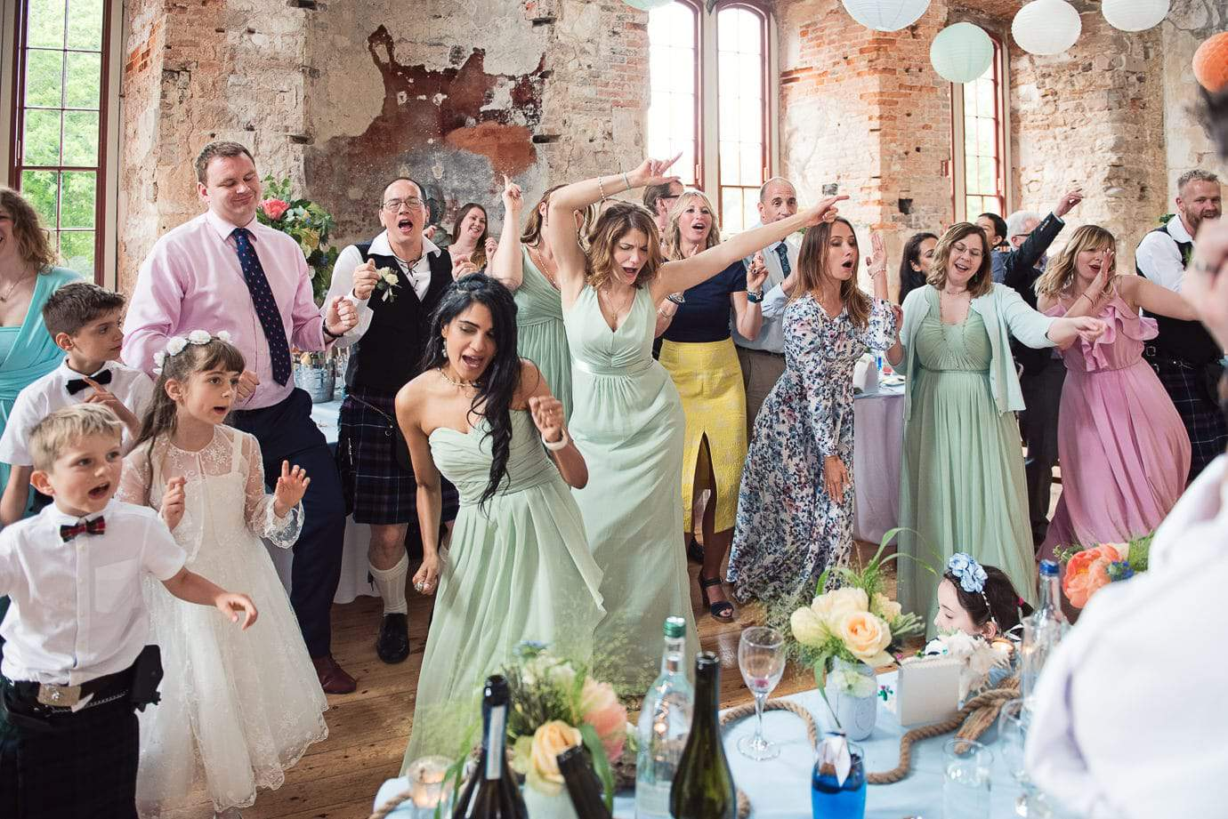 Flash mob dancing at Lulworth Castle wedding photograph one thousand words